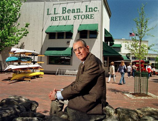 FILE - In this May 1999 file photo, Leon A. Gorman sits outside one of the company's stores in Freeport, Maine. Gorman, a grandson of L.L. Bean, who led a modernization of his family's outdoor clothing and gear retail business after the founder's death, died Thursday, Sept. 3, 2015, at his home in Yarmouth, Me. He was 80. (AP Photo/Robert F. Bukaty, File)