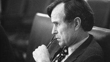 CIA_Director_George_H.W._Bush_listens_at_a_meeting_following_the_assassinations_in_Beirut,_1976_-_NARA_-_7064954