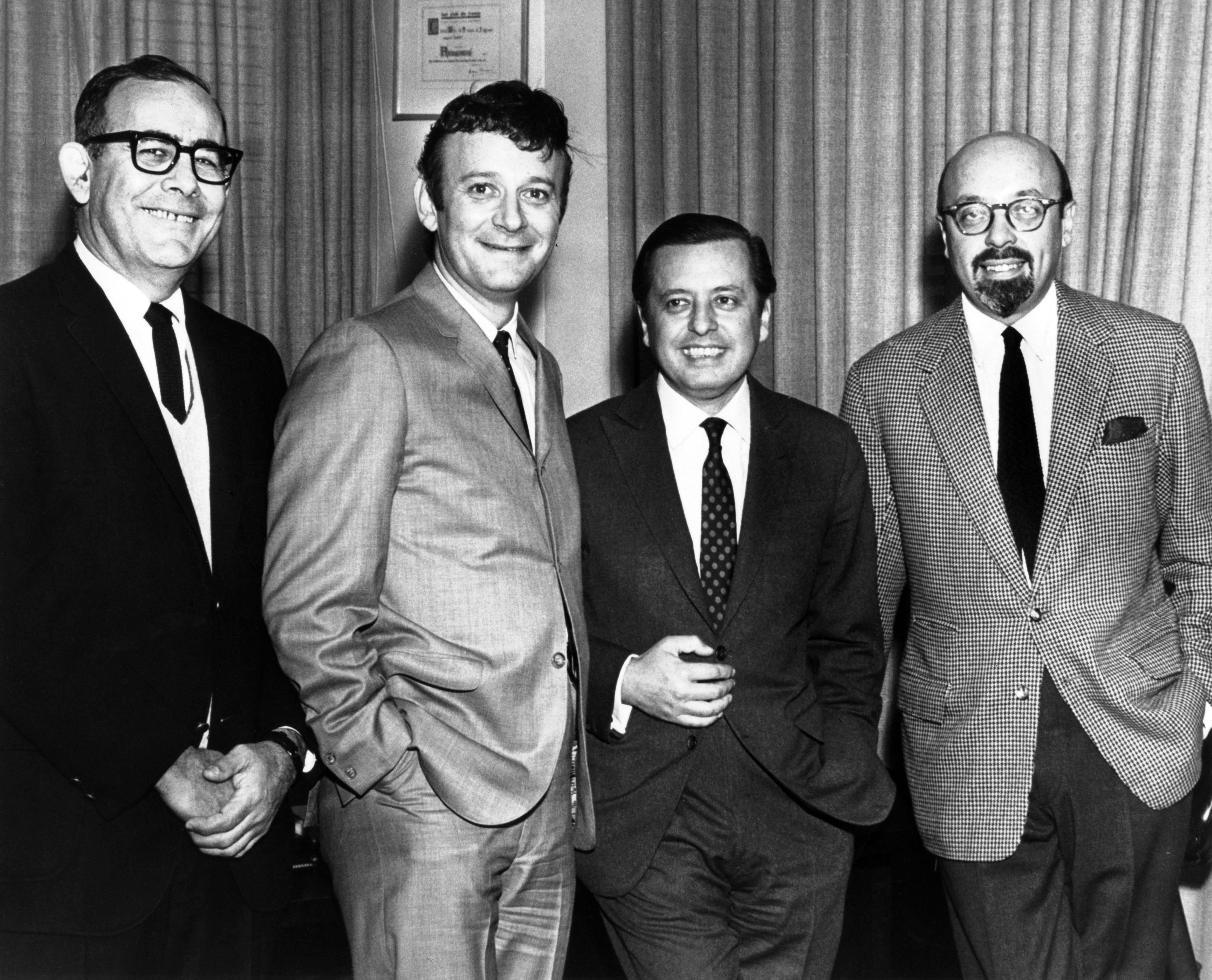 UNITED STATES - JANUARY 01: Photo of Bert BERNS and Ahmet ERTEGUN; L-R: ?, Bert Berns, ?, Ahmet Ertegun (founder of Atlantic Records) posed, (Photo by Charlie Gillett Collection/Redferns)