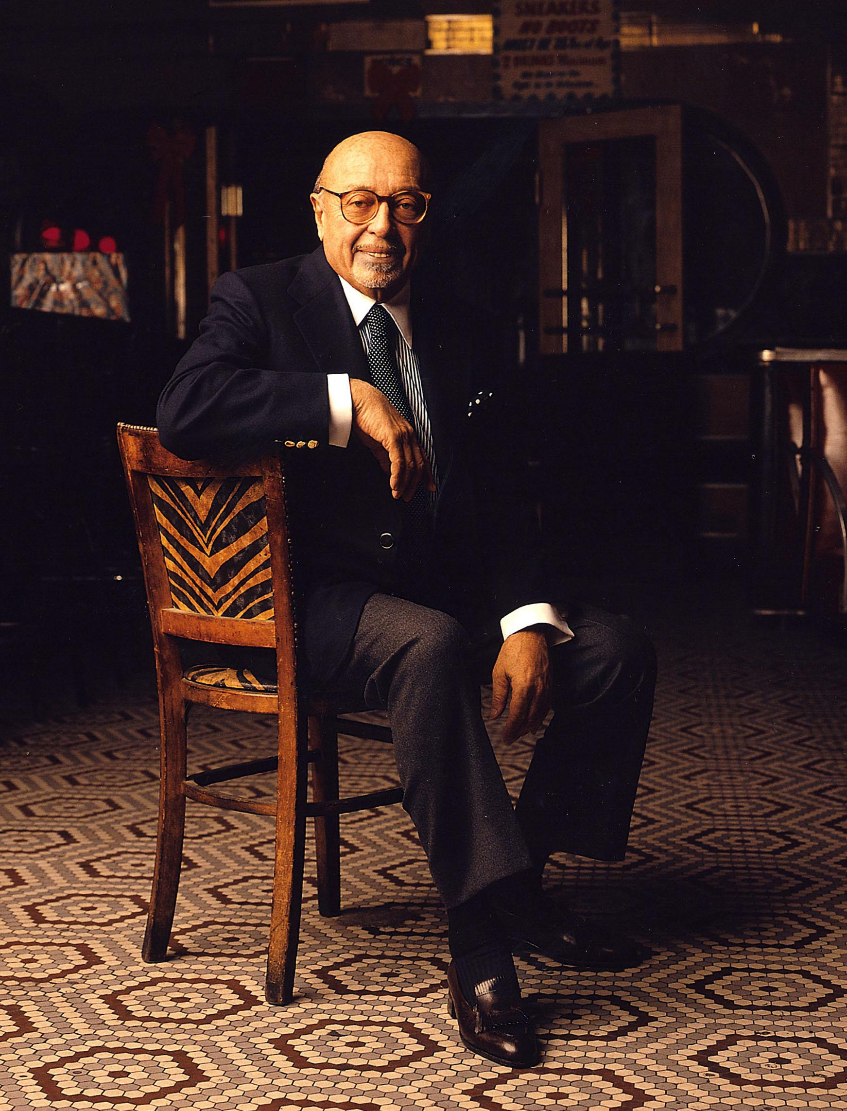 Ahmet Ertegun at the Lenox Lounge in Harlem, 1997. (Norma Jean Roy, courtesy of Atlantic Records Archive)
