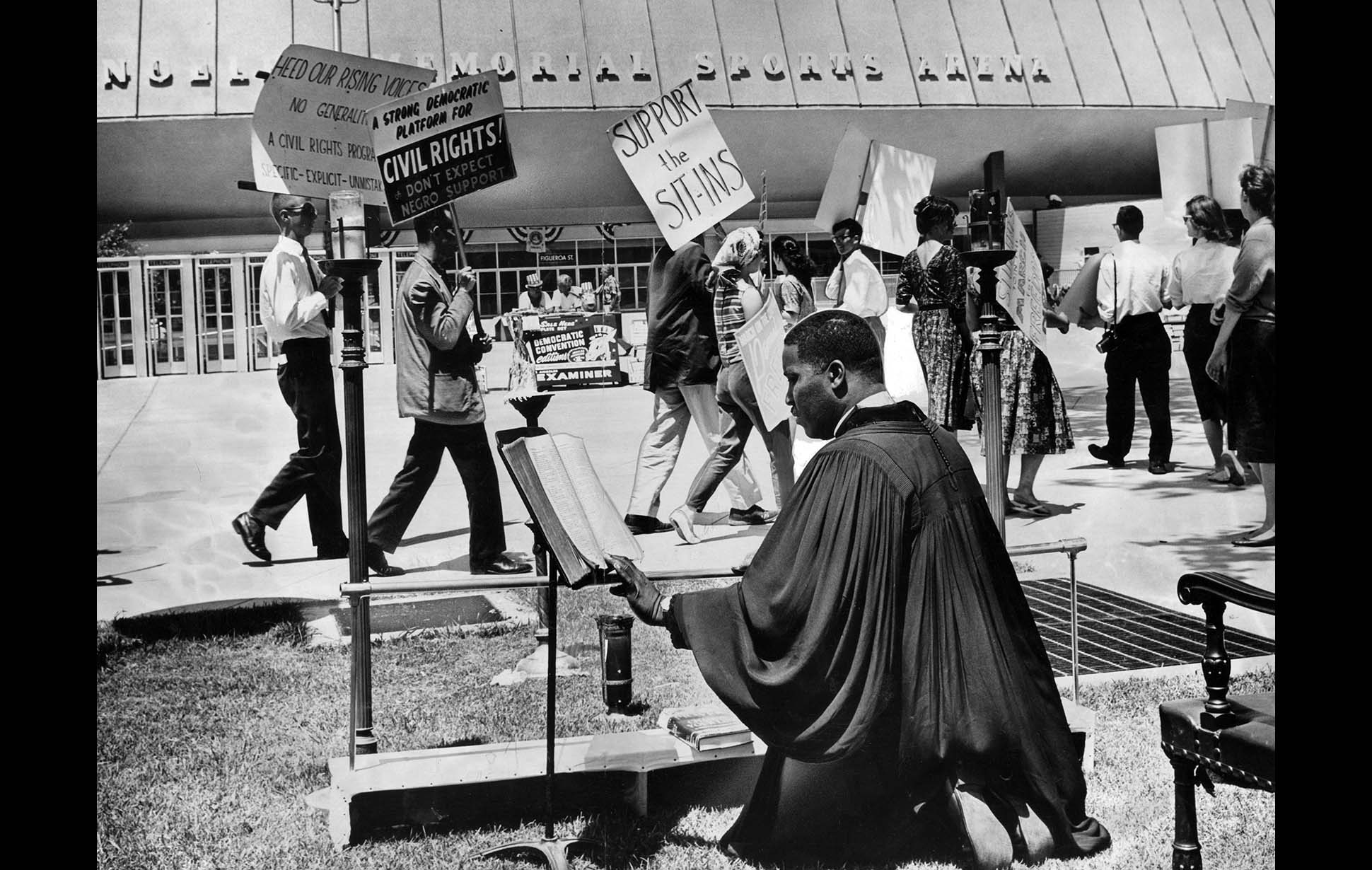 July 11, 1960: Rev. Maurice A. Dawkins engages in a 24-hour period of prayer and fasting outside of the Los Angeles Memorial Sports Arena during the Democratic National Convention. Dawkins and protestors were advocating a liberal civil rights platform. This photo was published in the July 12, 1960 LA Times.
