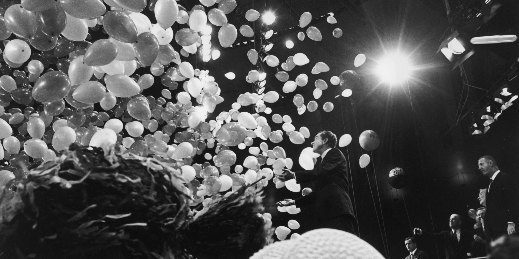31st October 1968: Republican presidential candidate Richard Nixon (1913-1994) is showered by balloons while standing on stage at a political rally in Madison Square Garden, New York City. (Photo by Santi Visalli Inc./Getty Images)